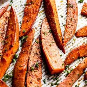 roasted sweet potato wedges garnished with chopped parsley