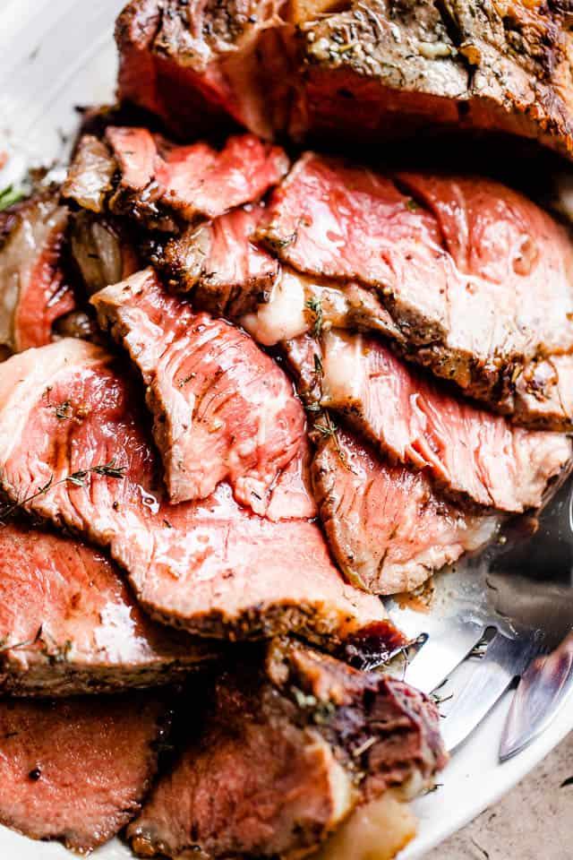 close up shot of sliced prime rib roast served on a platter