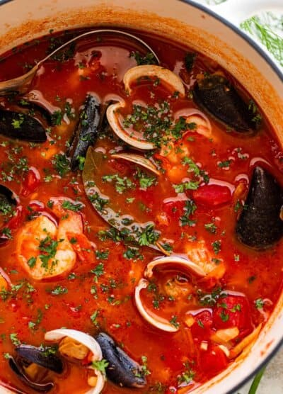 overhead close up photo of cioppino in a dutch oven