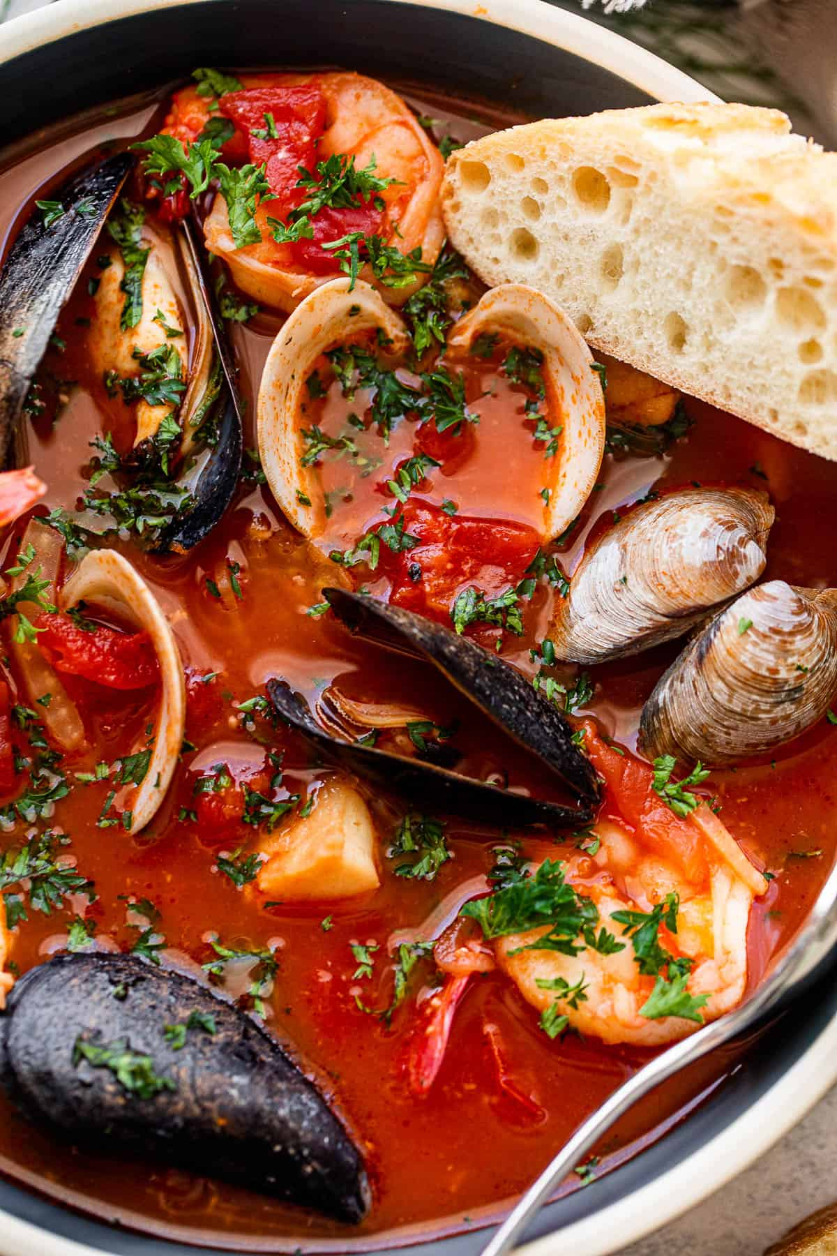 close up shot of cioppino stew in a soup bowl