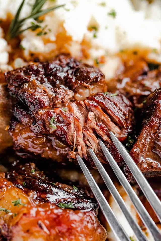 fork tearing at short ribs