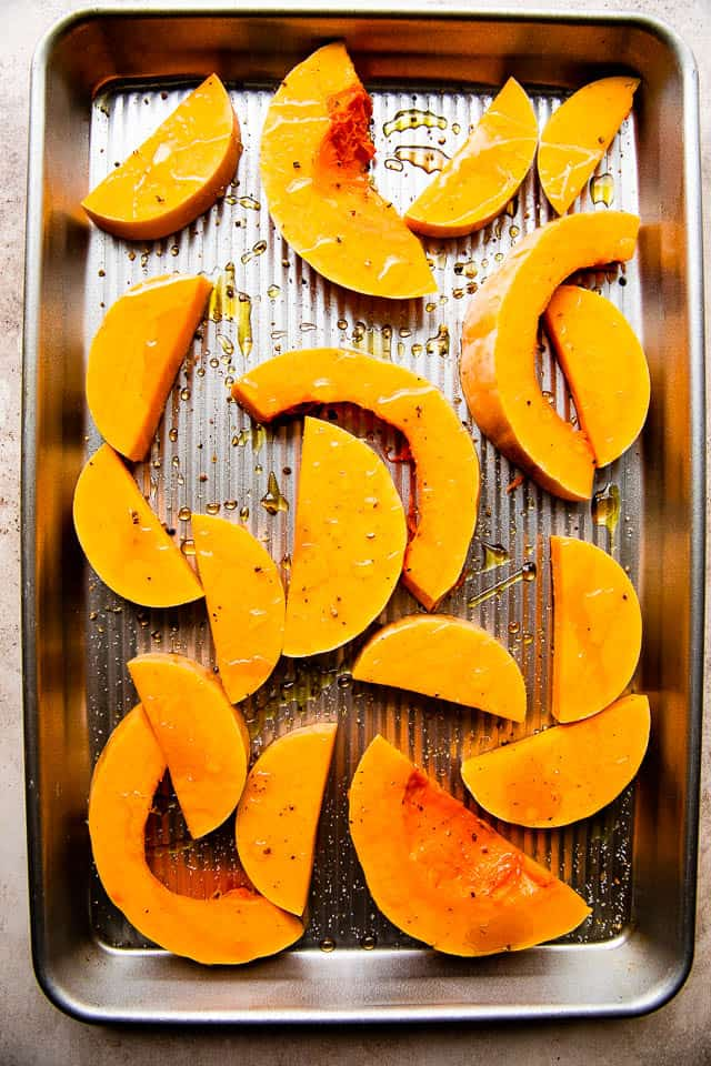 baking sheet with thick slices of butternut squash