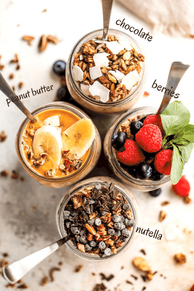 overhead shot of overnight oatmeal in jars topped with various ingredients