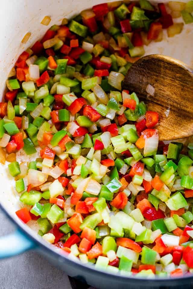 sauteeing diced peppers and onions in a dutch oven
