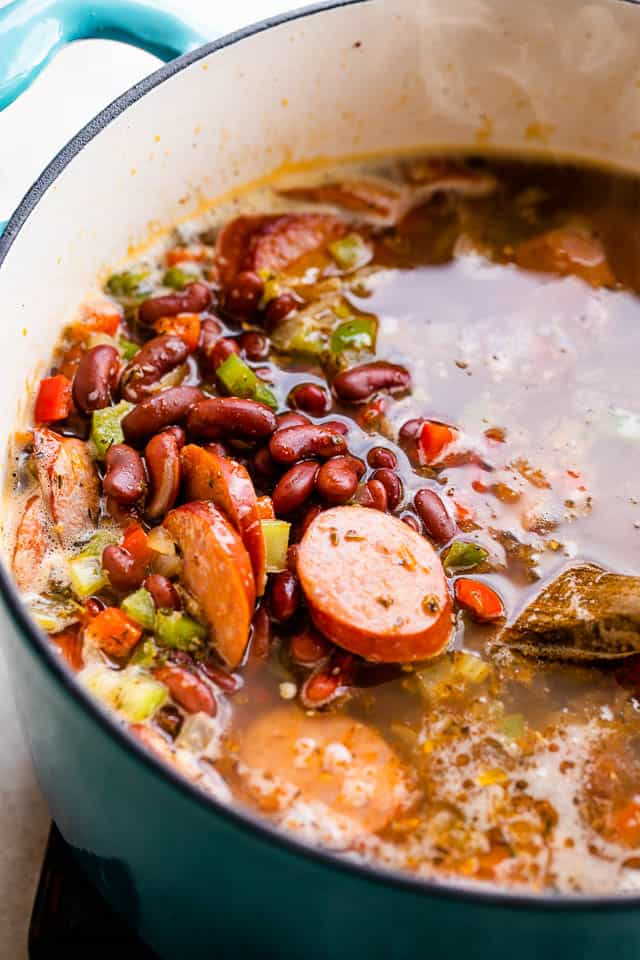cooking red beans, sausage, and diced veggies in a pot