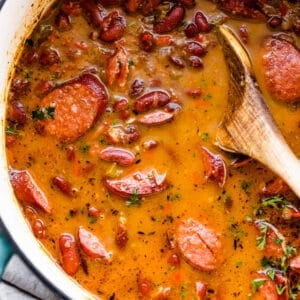 cooked red beans and sausage in a dutch oven