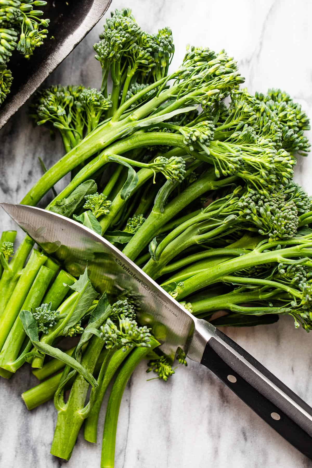 trimming broccolini with a knife