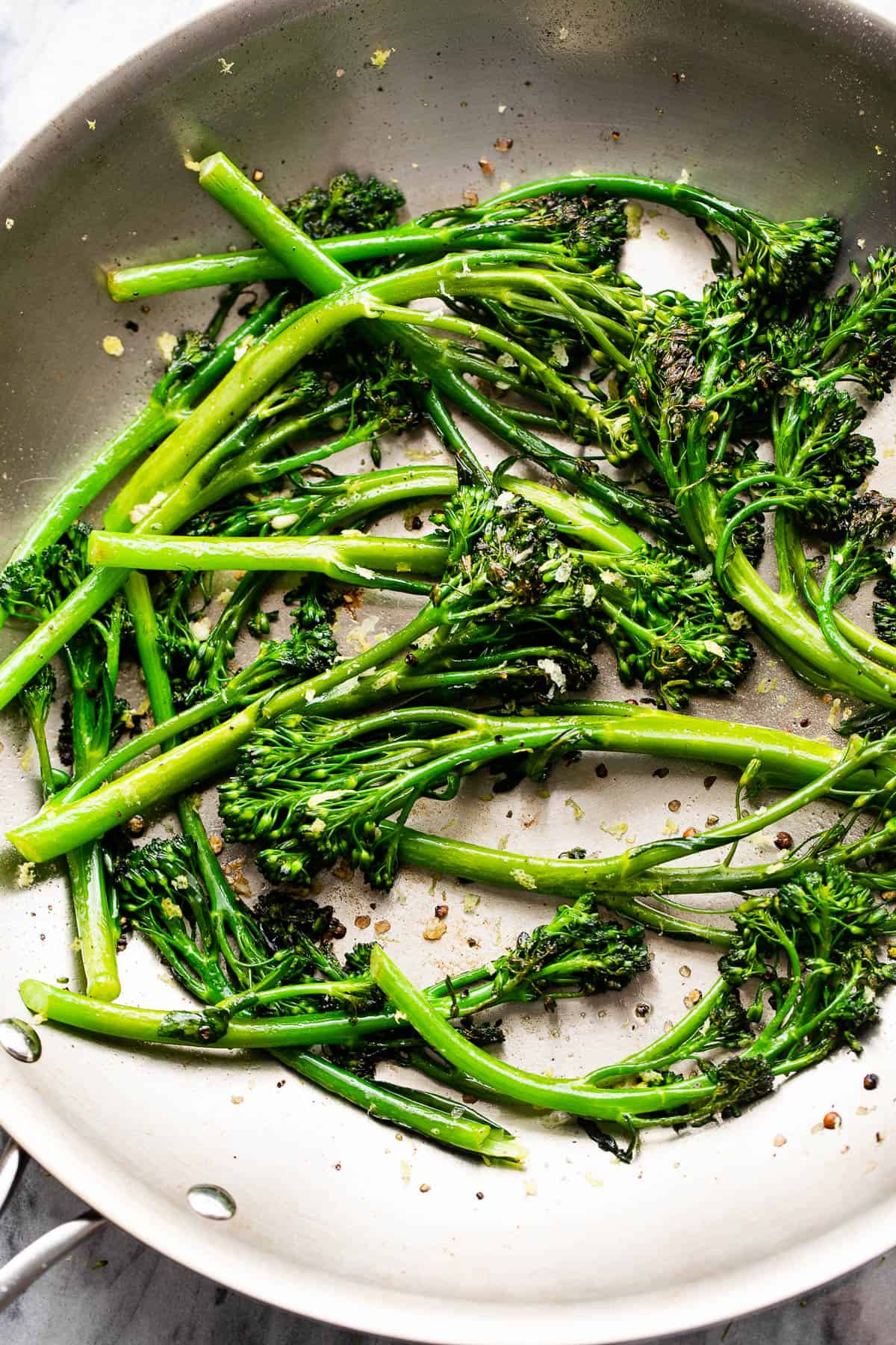 sauteeing broccolini in a skillet