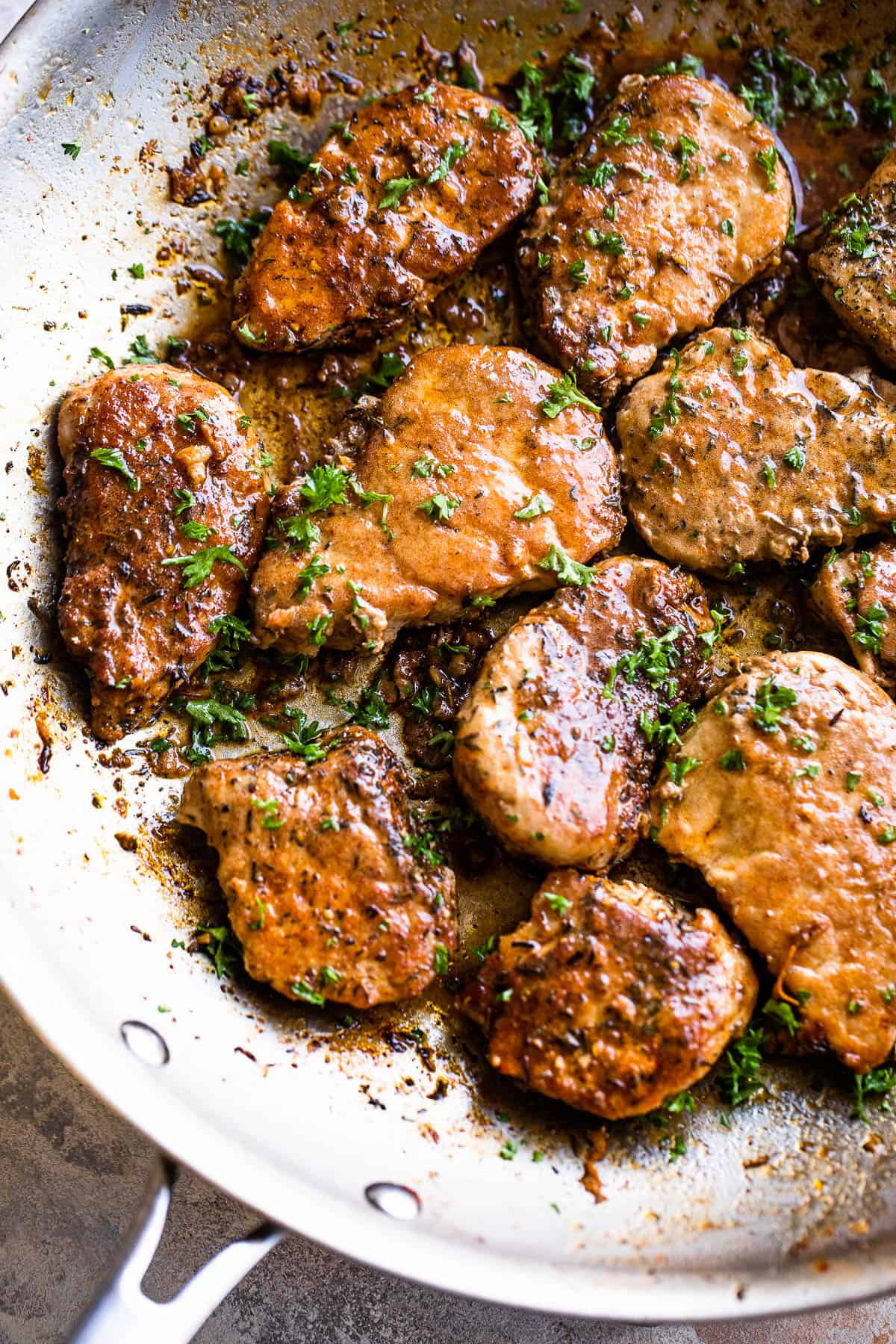 pork medallions in a stainless skillet