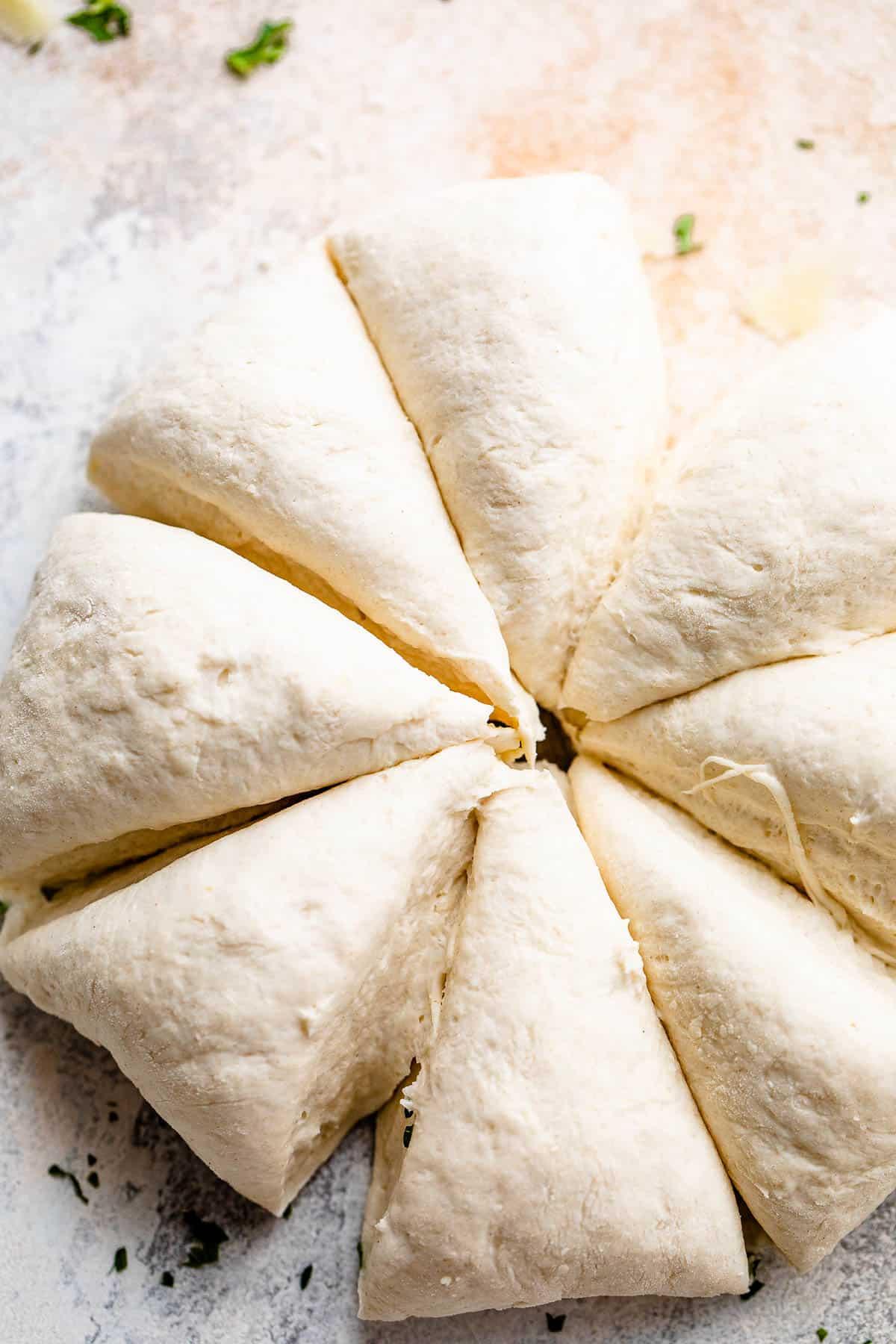 ball of dough cut into eight pieces