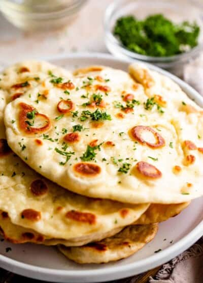 stacked naan bread served on a plate