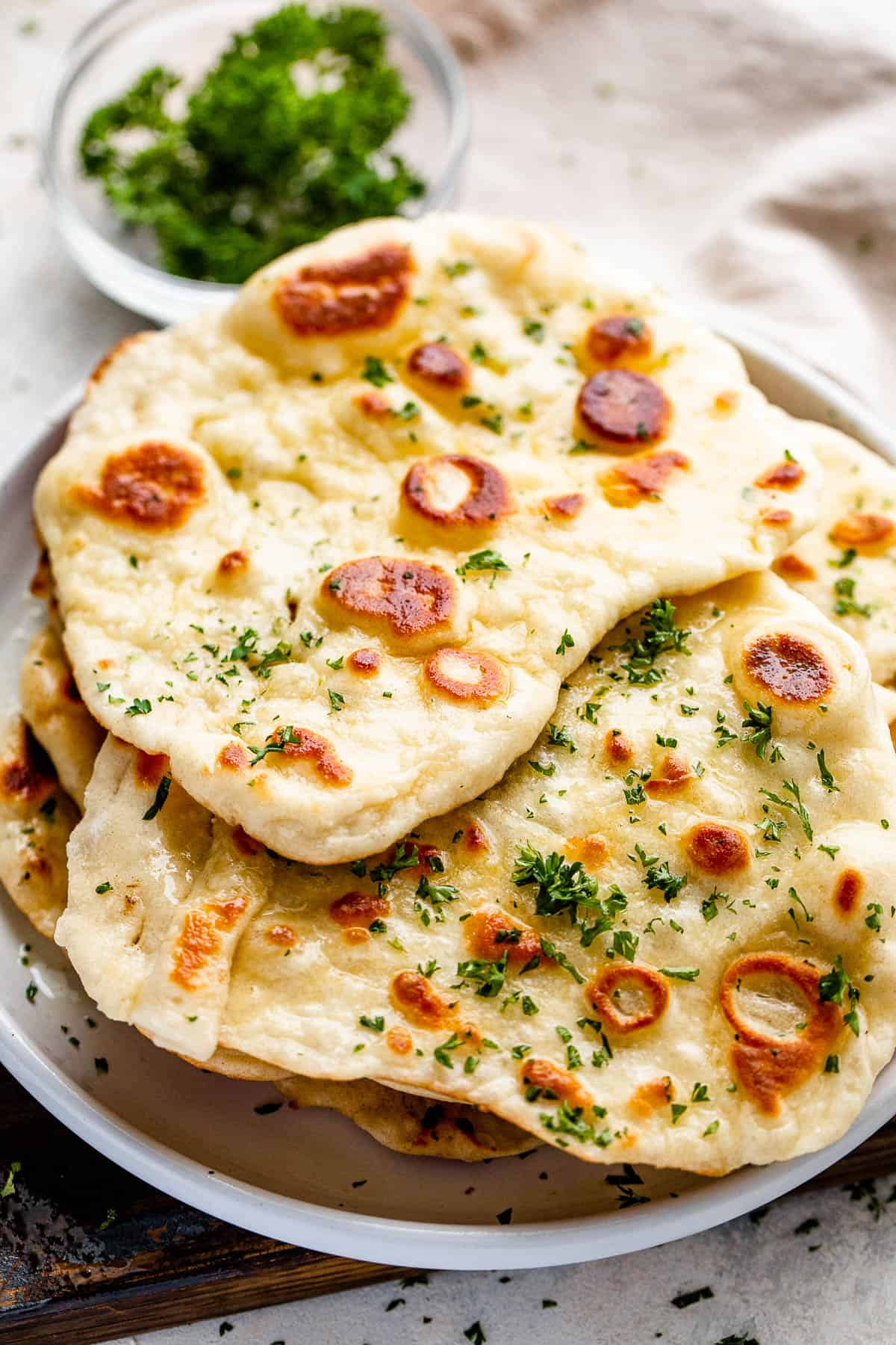 overhead shot of a stack of naan bread