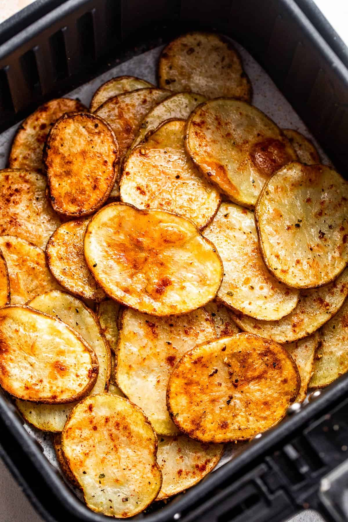 baked potato chips in an air fryer basket