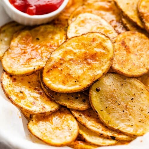 serving air fryer potato chips with a small bowl of ketchup on the side