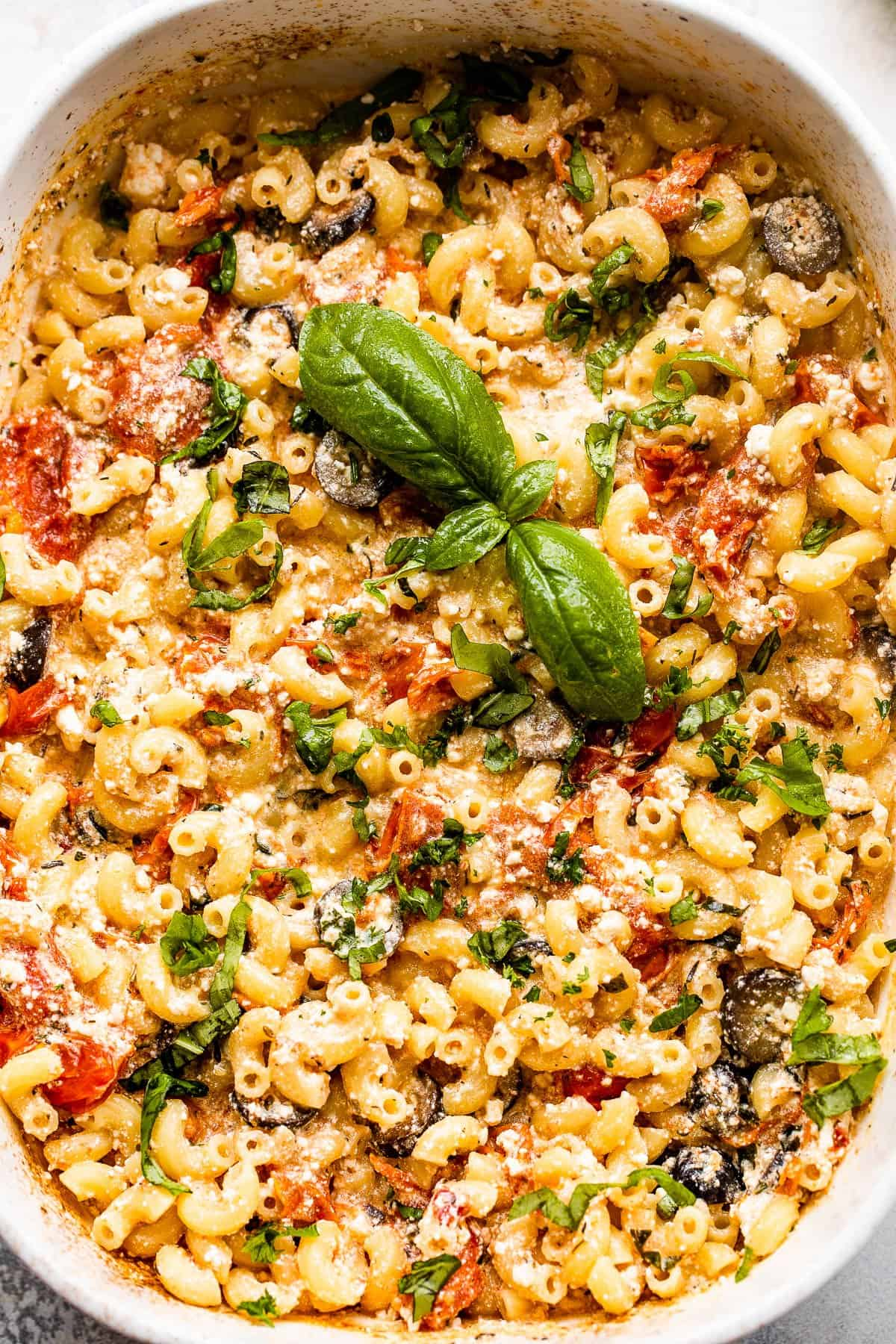 overhead shot of baked elbow macaroni with feta cheese sauce