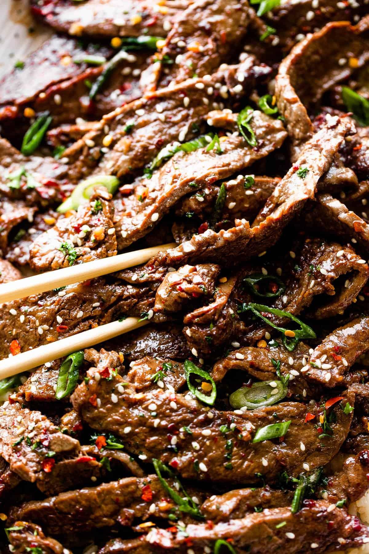 picking up beef bulgogi with chopsticks