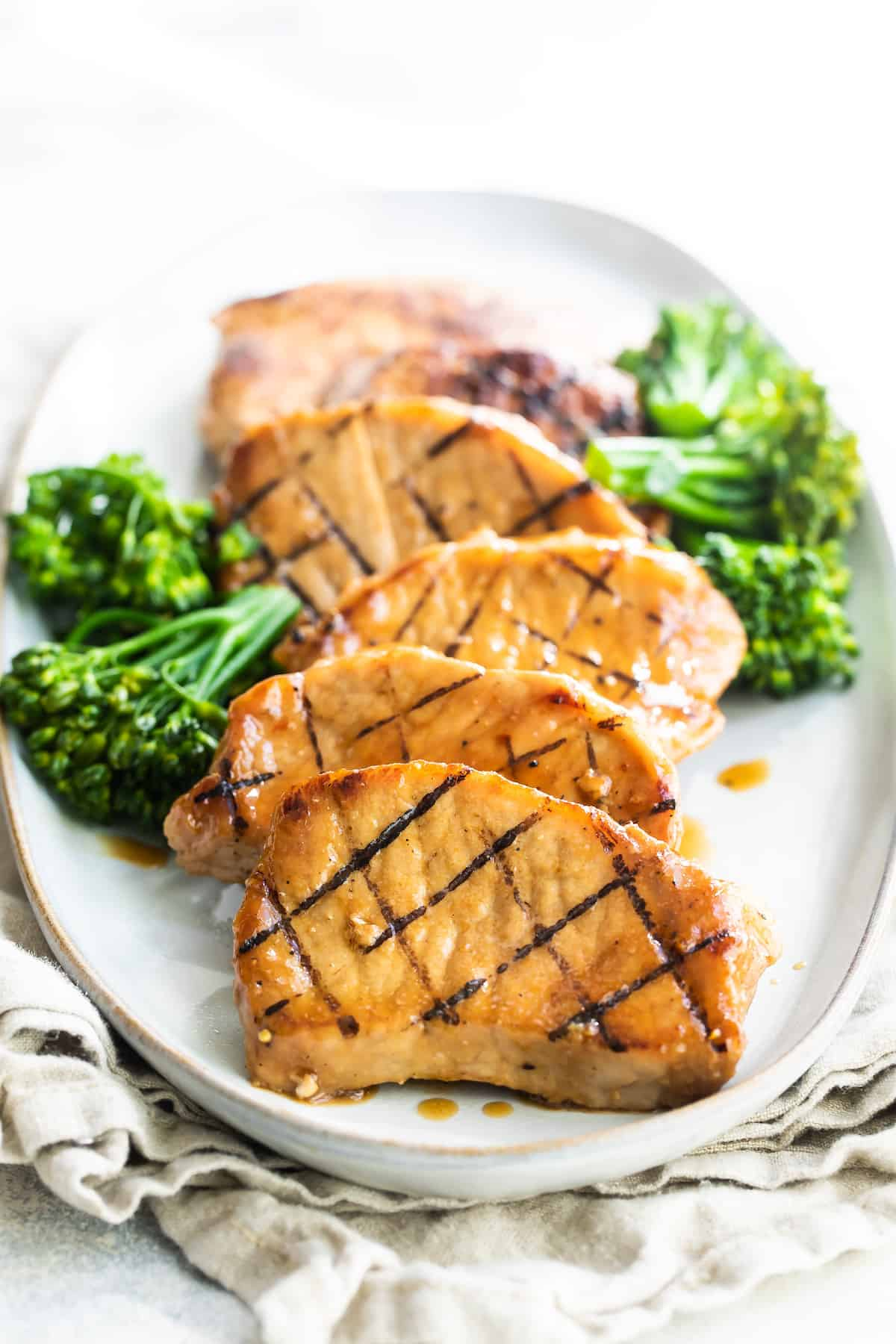 Six Honey Soy Pork Chops on a Plate with Broccoli on the Side