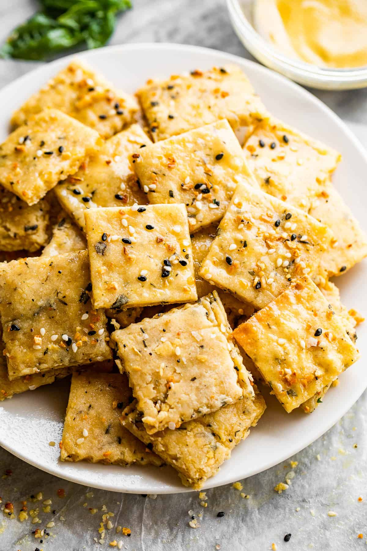 homemade cheese crackers served on a white plate