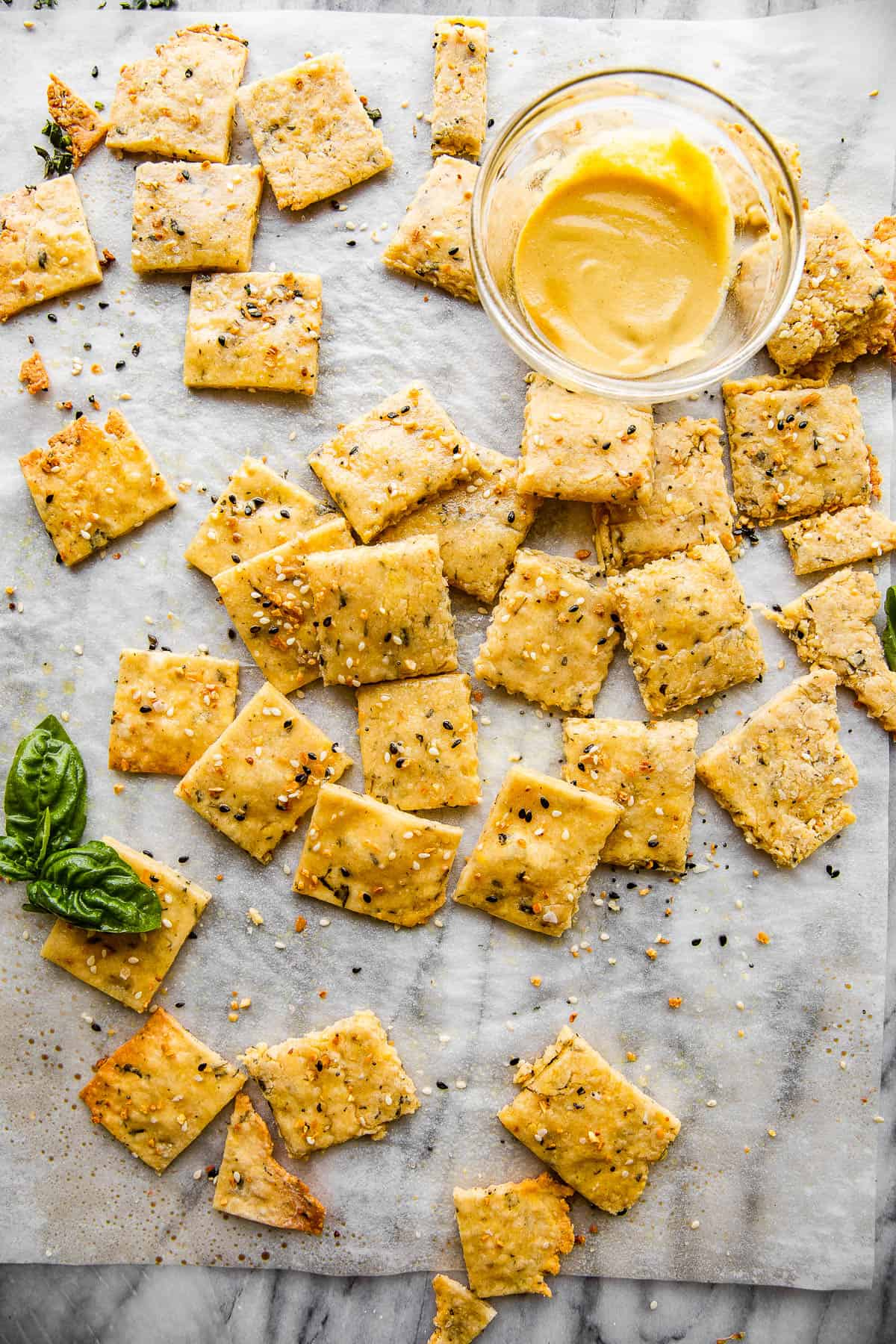 overhead shot of homemade cheese crackers and a bowl of honey mustard dip