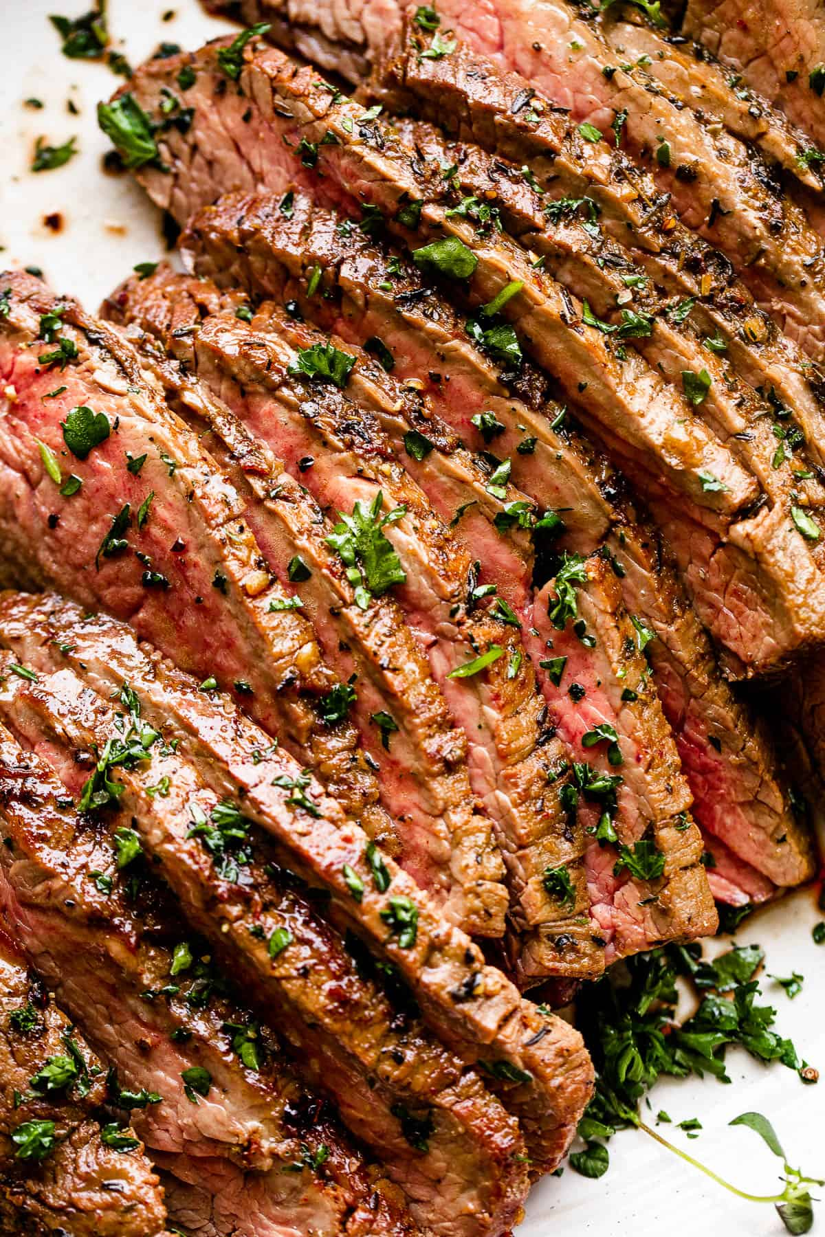 sliced london broil garnished with parsley