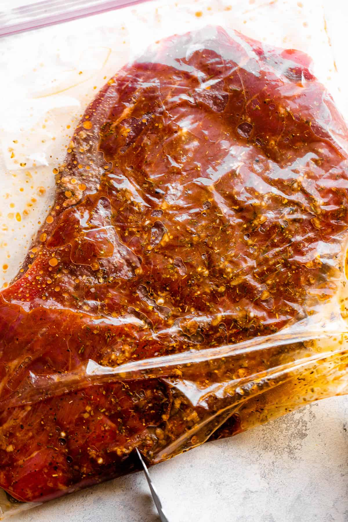 marinating flank steak in a ziploc bag