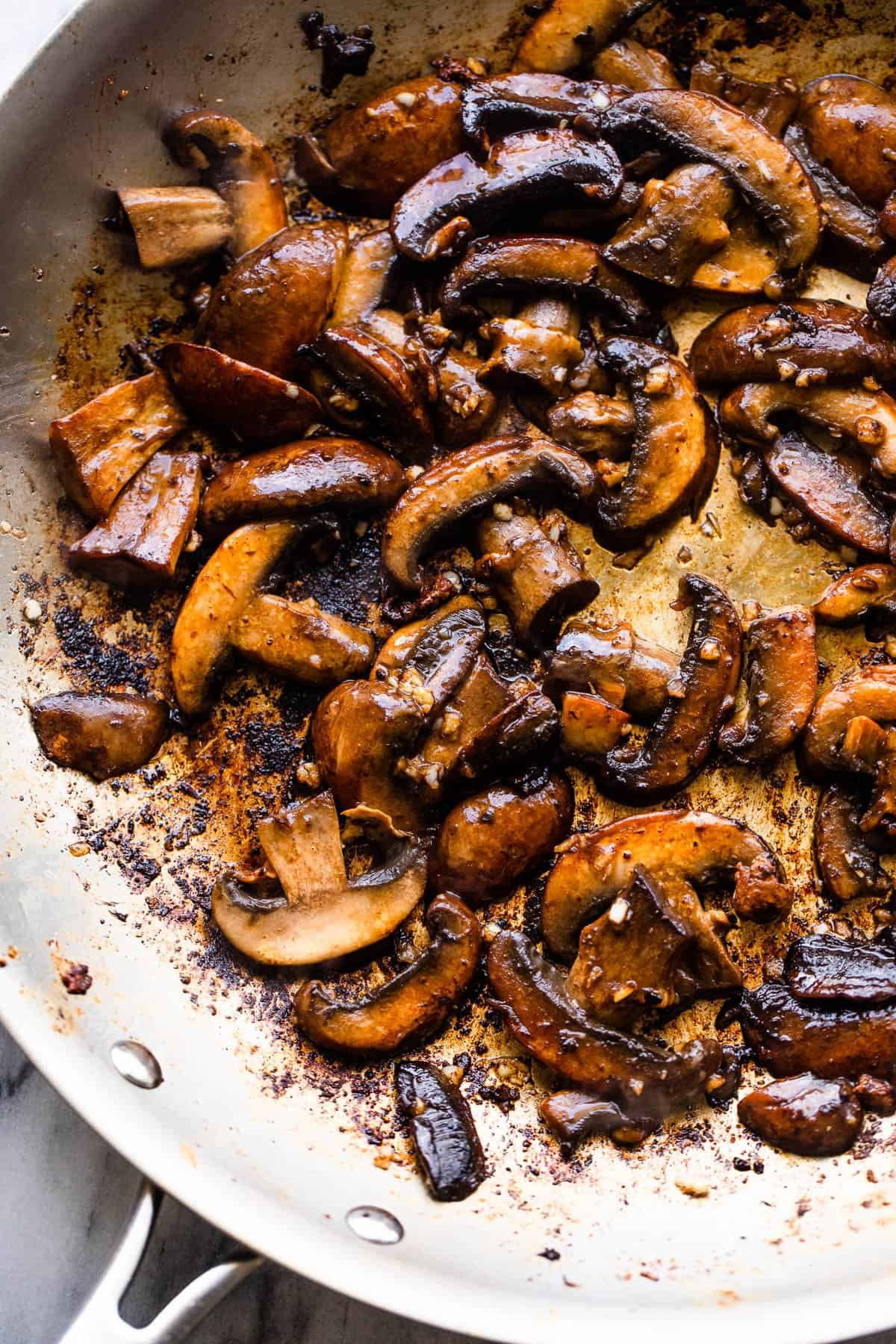 sauteeing mushrooms in a skillet