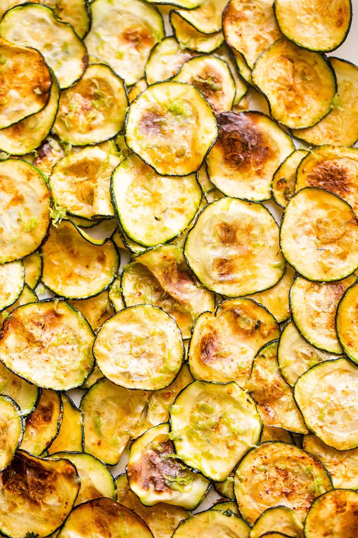 up close picture of zucchini chips cooked in an air fryer