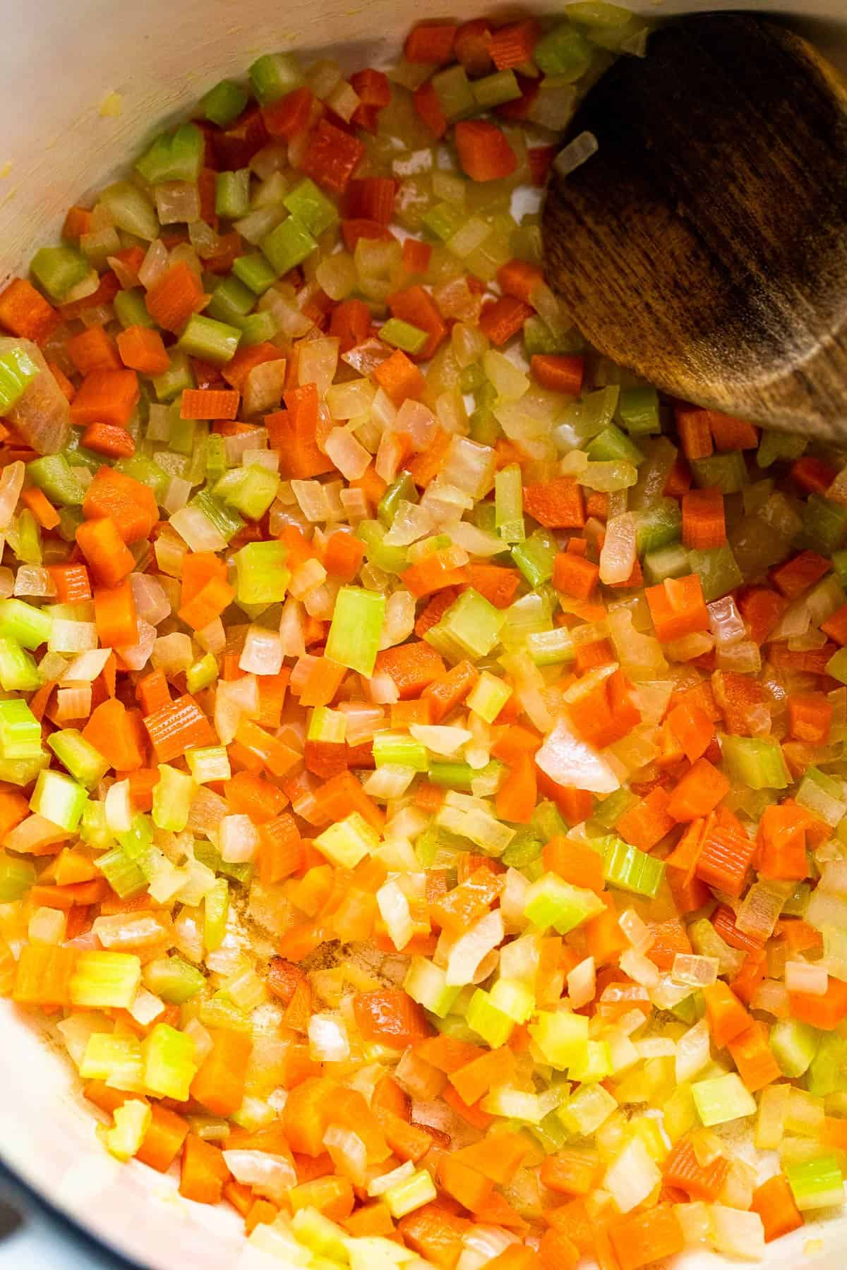 frying carrots and celery in a dutch oven