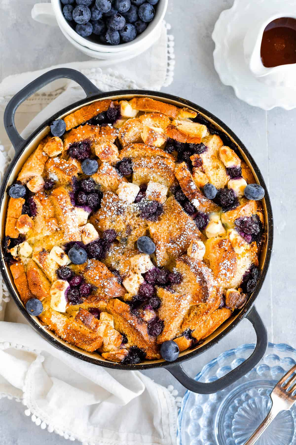Overhead shot of a round baking dish with Baked Blueberry French Toast