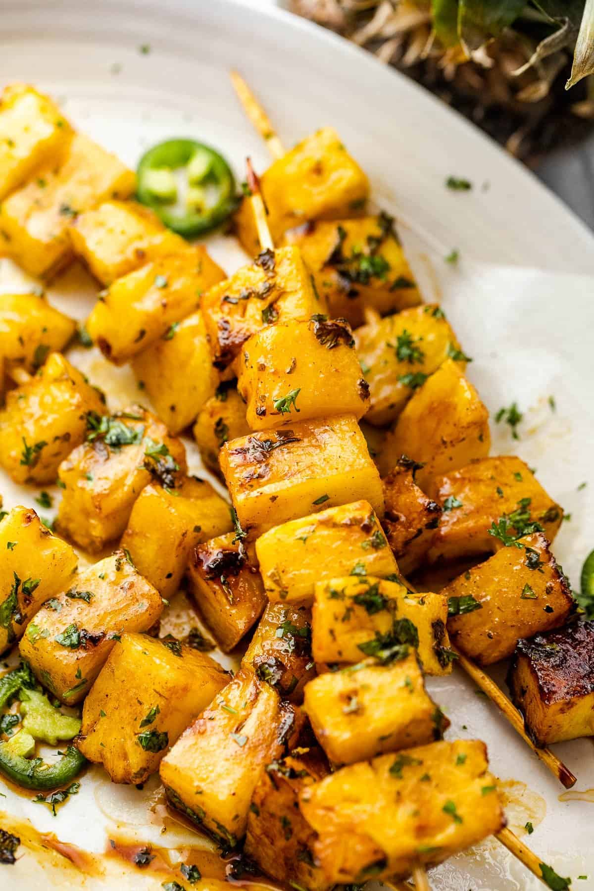 Tequila Grilled Pineapple Skewers served on a long white plate