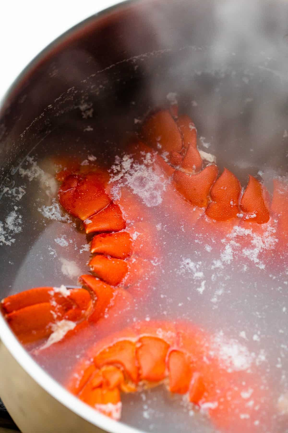 boiling lobster tails in a pot