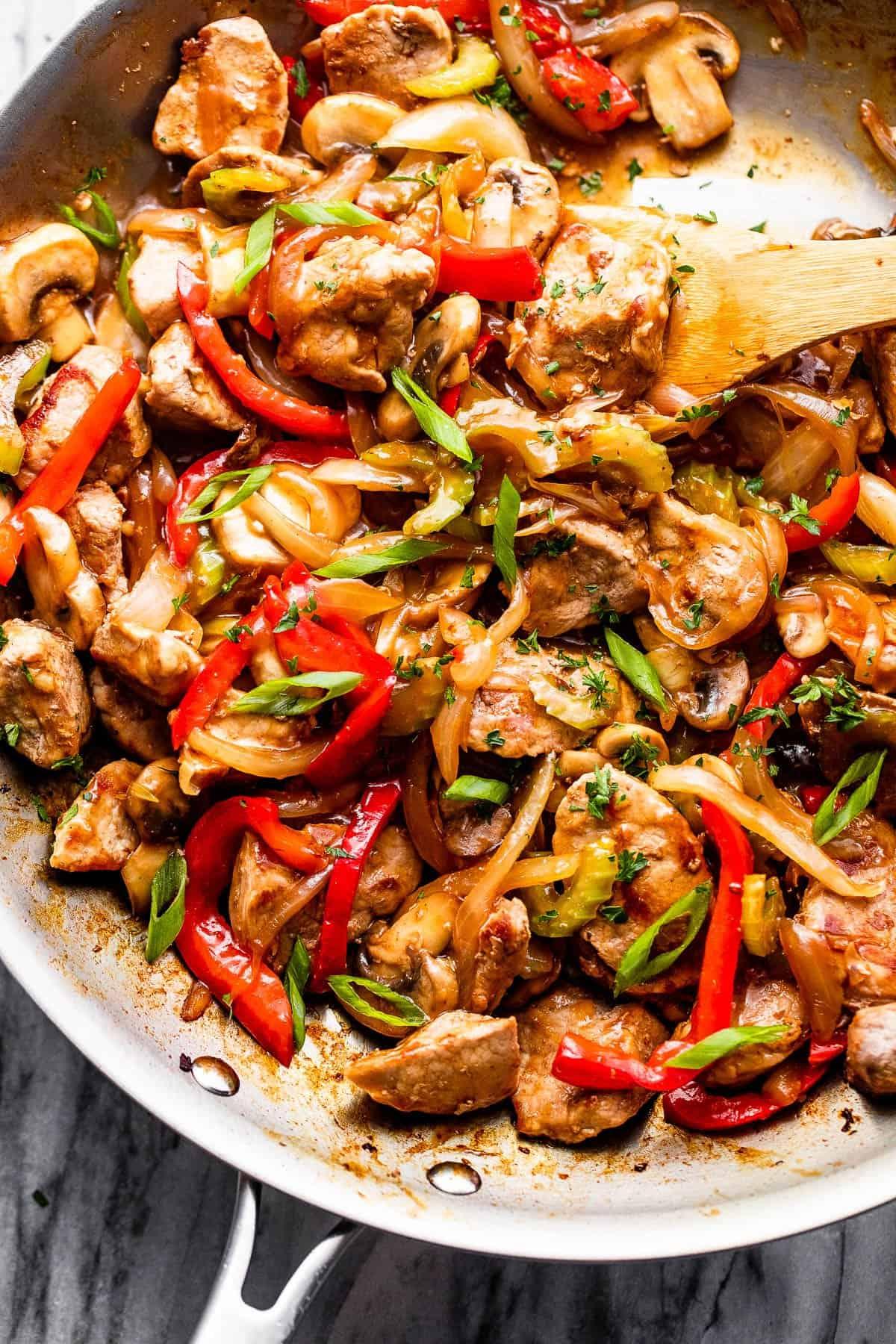 cooking pork chop stir fry in stainless skillet
