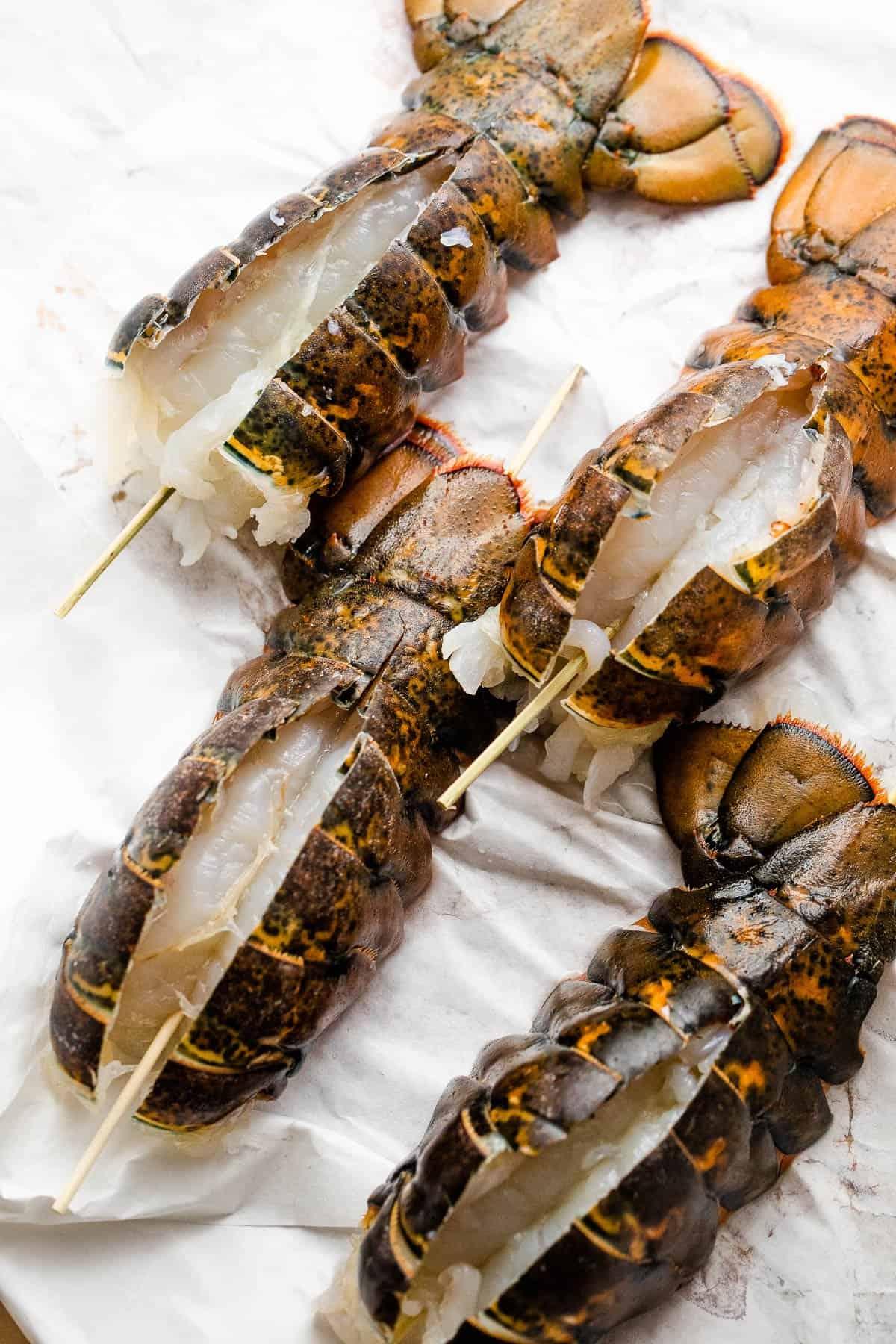 four fresh raw lobster tails