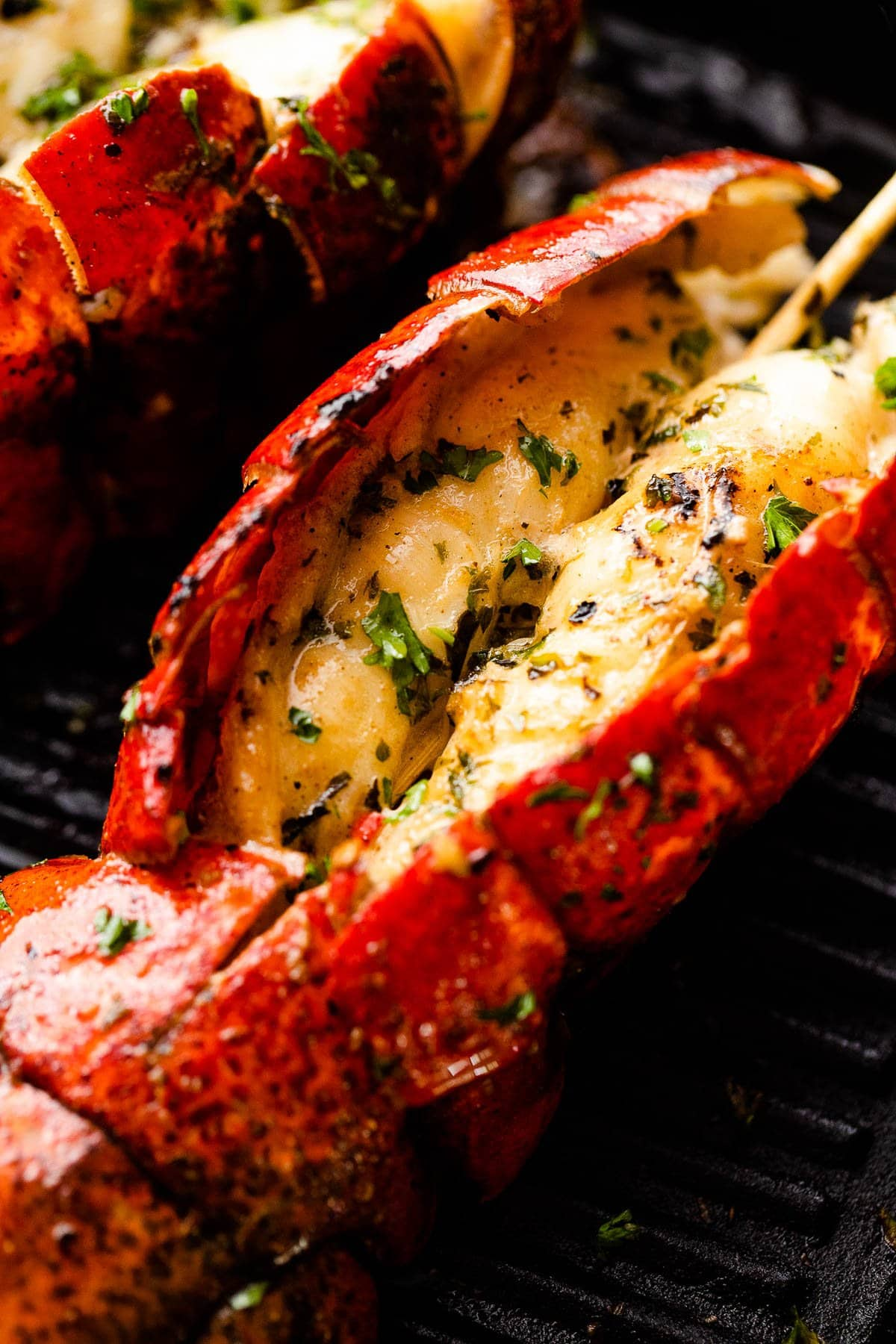 grilling lobster on a black grill pan