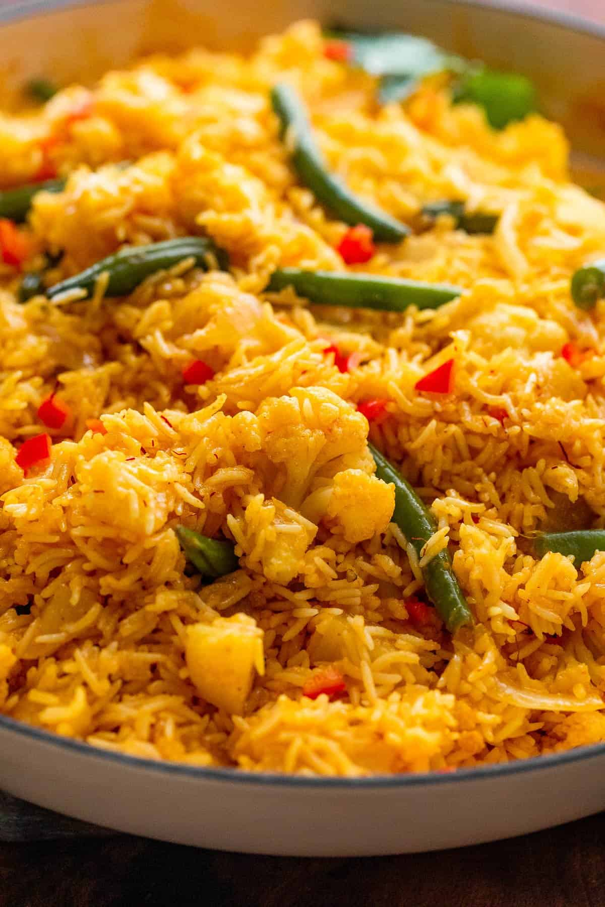 Vegetable Biryani Rice topped with green beans and red peppers
