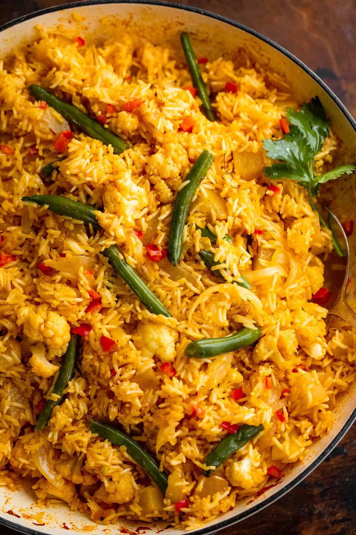 Vegetable Biryani Rice in a white baking dish
