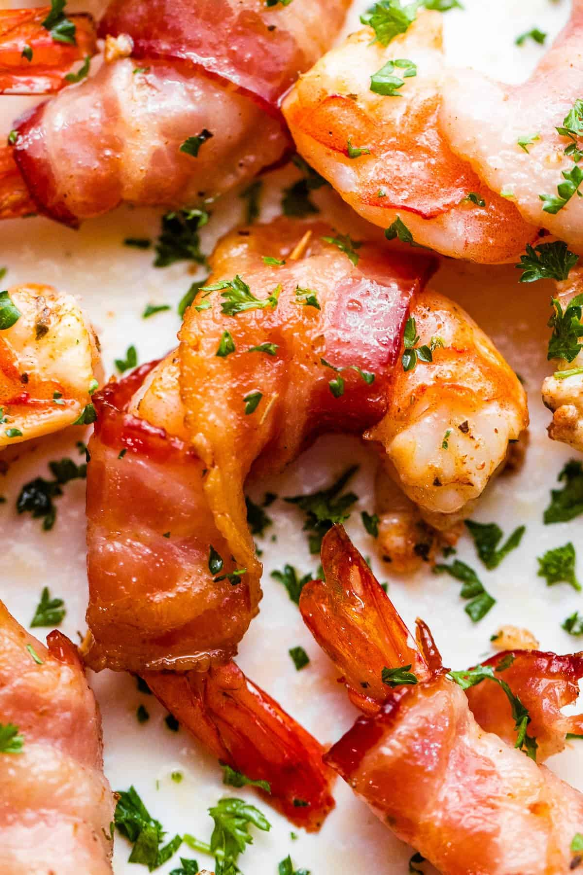 Grilled Bacon Wrapped Shrimp sprinkled with parsley