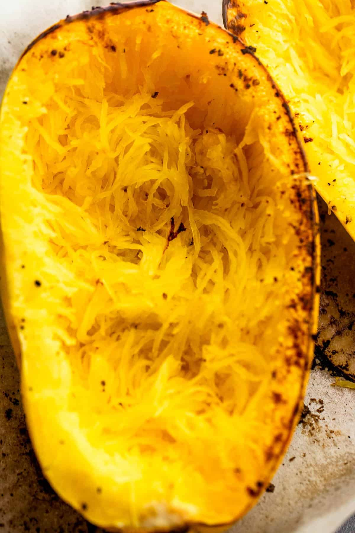 halved spaghetti squash with stringy insides