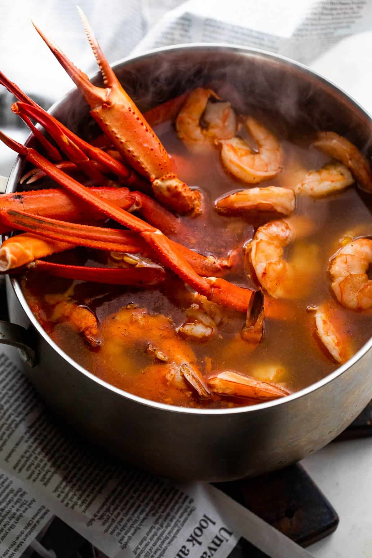 boiling crab legs and shrimp in a stockpot