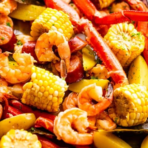 shot of seafood boil with crab legs, shrimp, corn, potatoes, and sausages