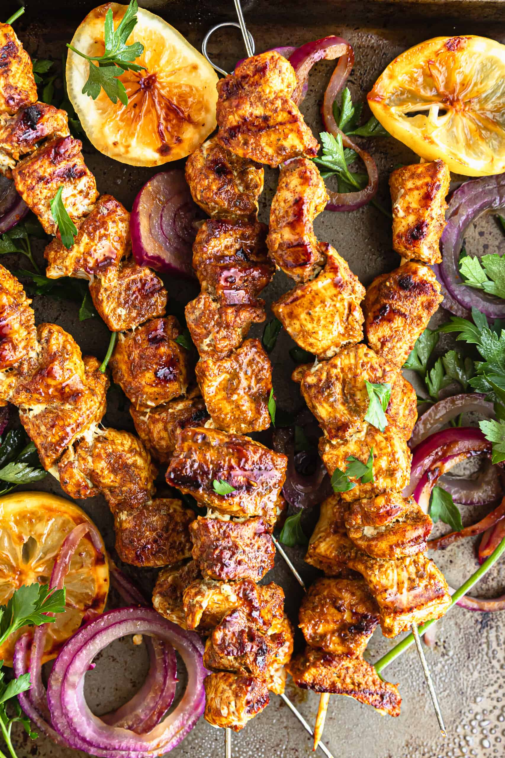 Grilled Chicken Shawarma Skewers arranged on a serving plate