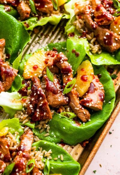 close up of pork lettuce wraps on a sheet pan