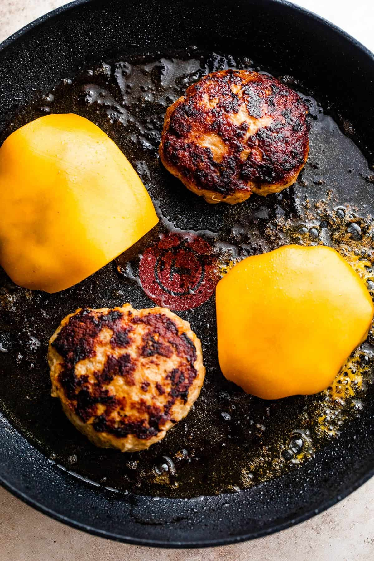 cooking turkey burgers in a skillet