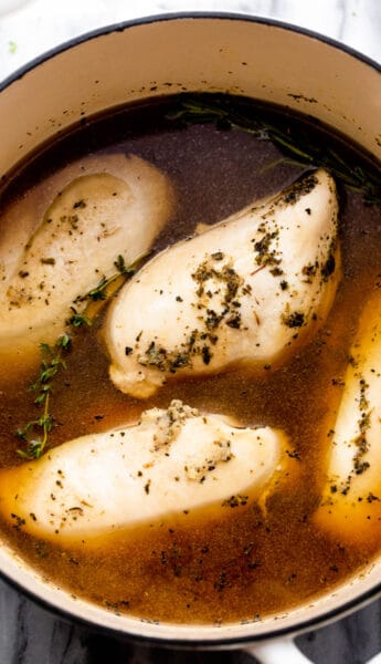 boiled chicken breasts in a dutch oven