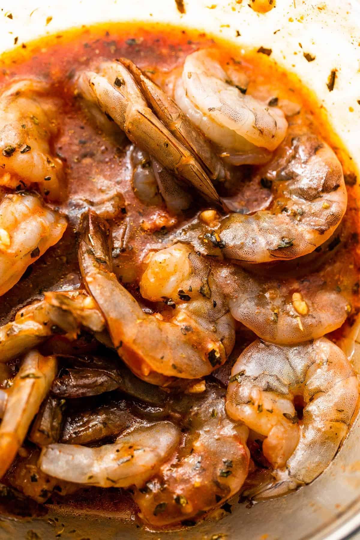 marinating raw shrimp in tomato sauce