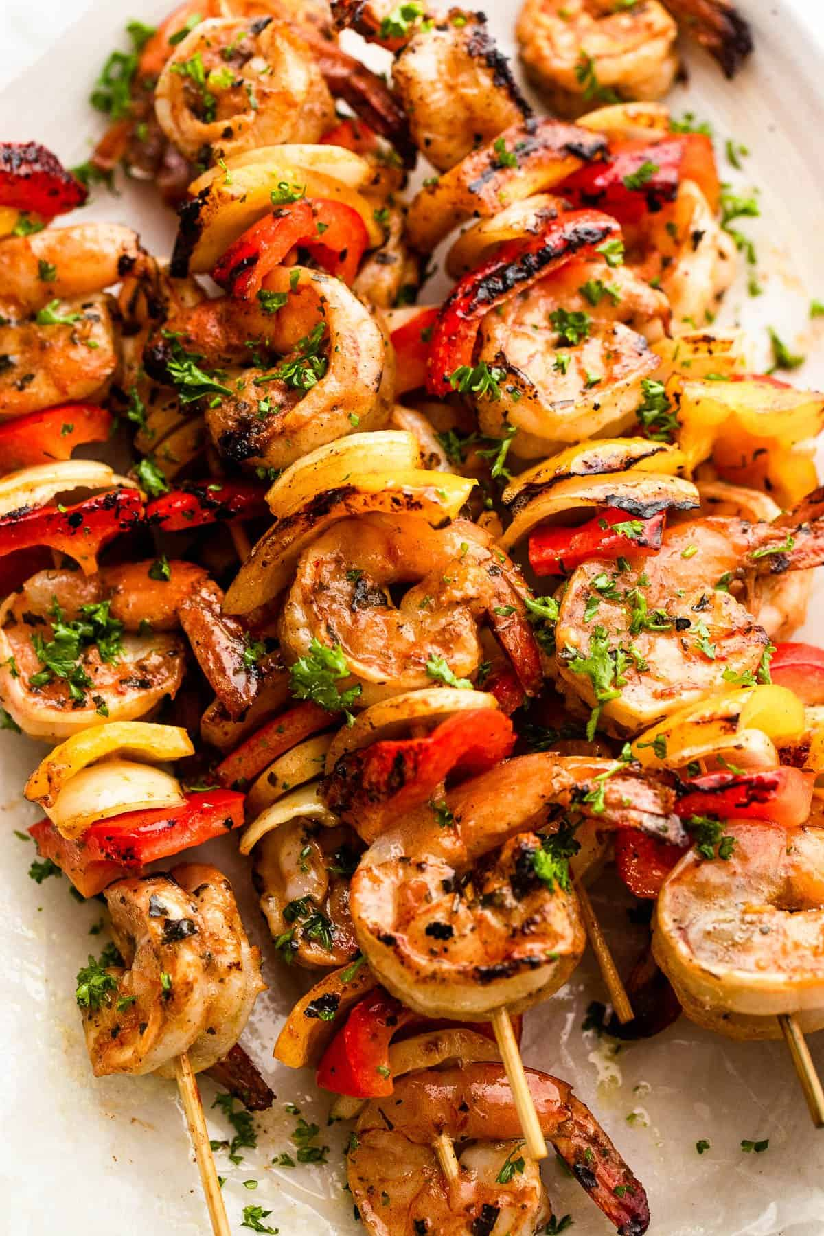 grilled shrimp, peppers, and onions, on skewers