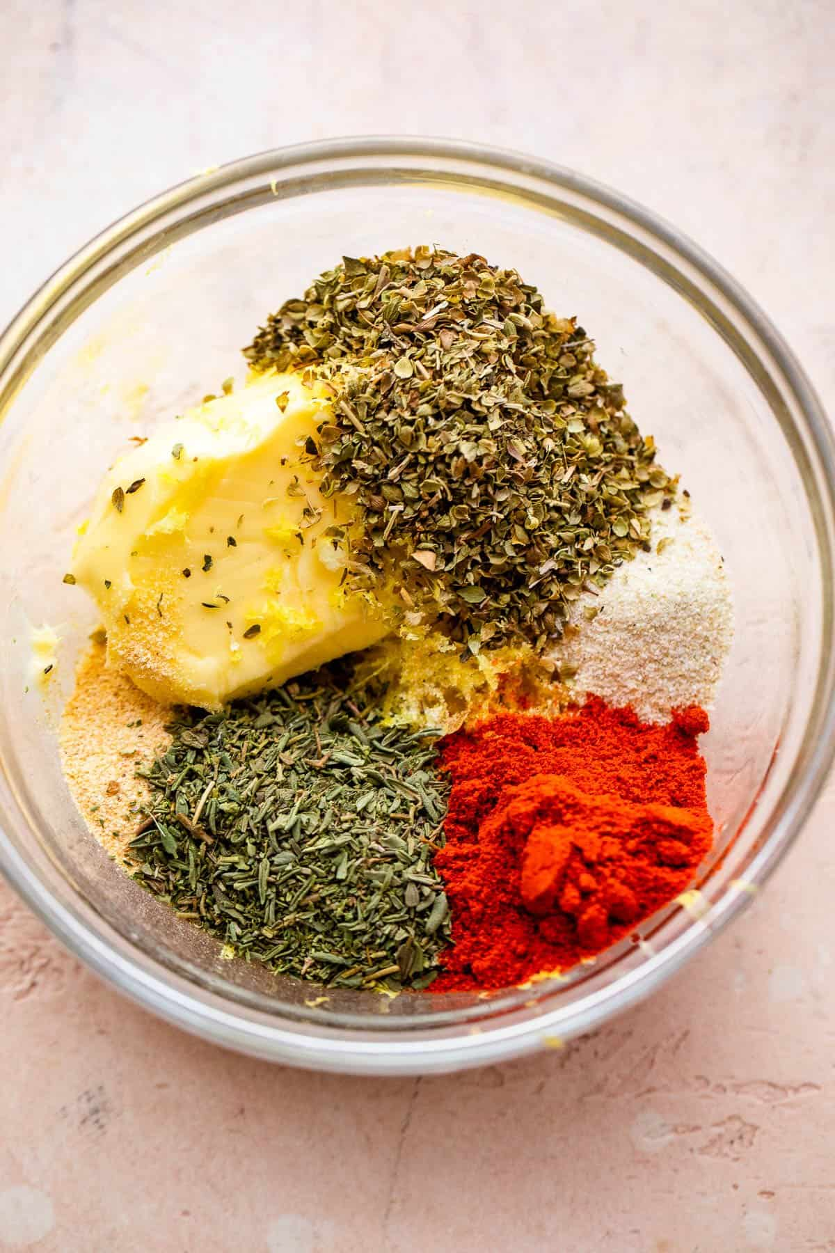 seasonings arranged in a round glass mixing bowl