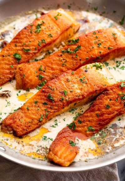 cooking four salmon fillets in cream sauce
